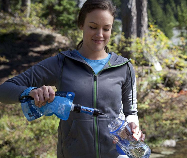 filling a bottle with the sawyer mini water filter